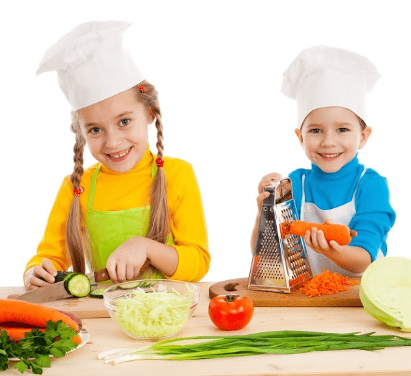 kids using cutting board in kitchen