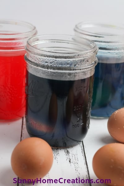 Eggs being dyed with food coloring