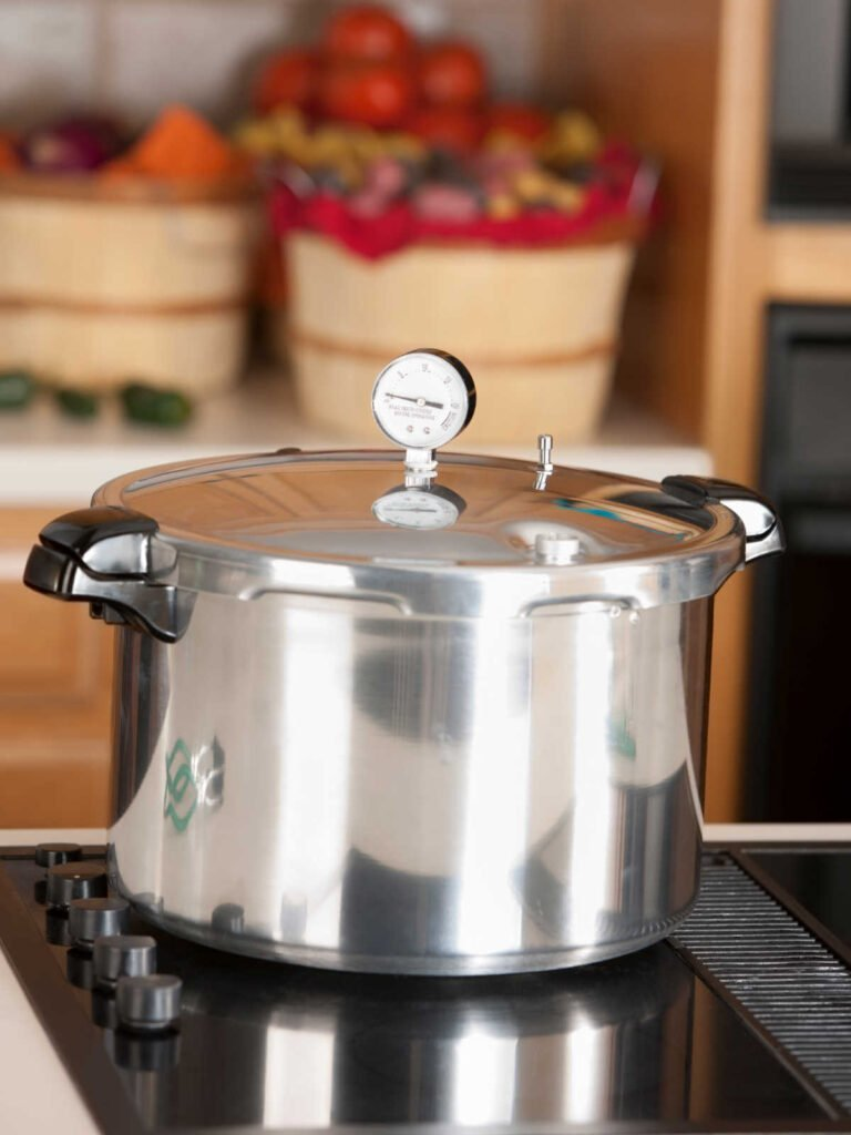 Pressure canner on stove.