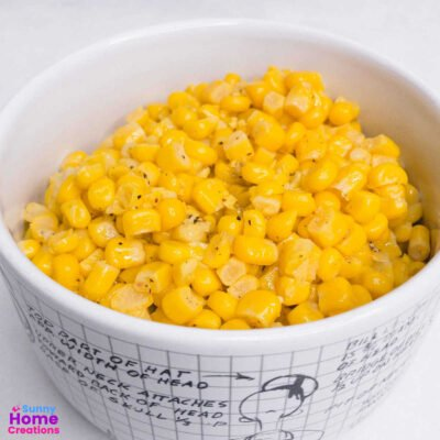 canned corn that has been cooked in a bowl.